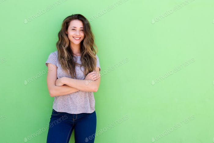 happy young woman standing with folded arms