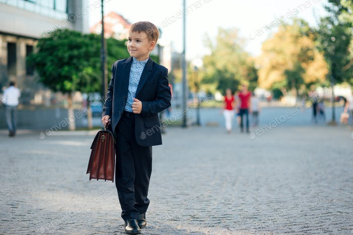 Future businessman in formal costume with briefcase