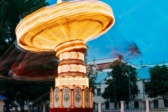 Blurred Motion Effect Of Illuminated Rotating Carousel Merry-Go-