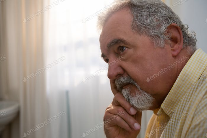 Close up of thoughtful senior man looking away