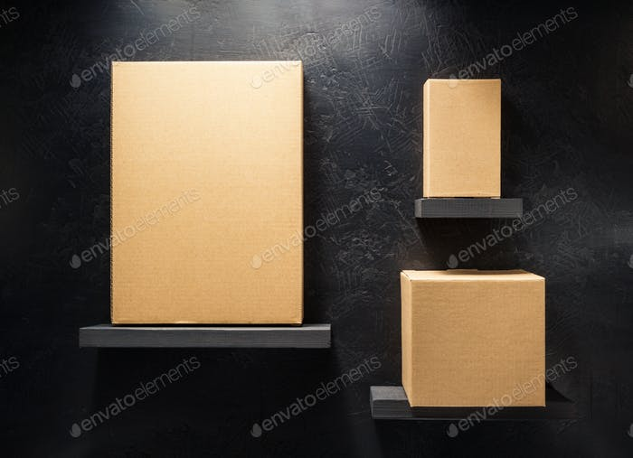 cardboard box on wooden shelf
