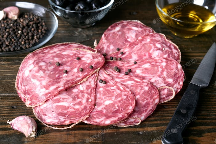 slices of Iberian sausage on wooden board