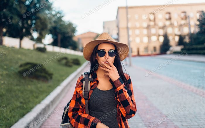 Female tourist on smoke break during the excursion
