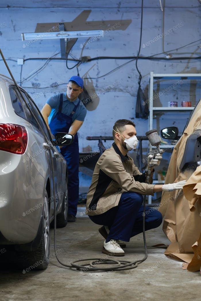 Two Men Working In Auto Service Center