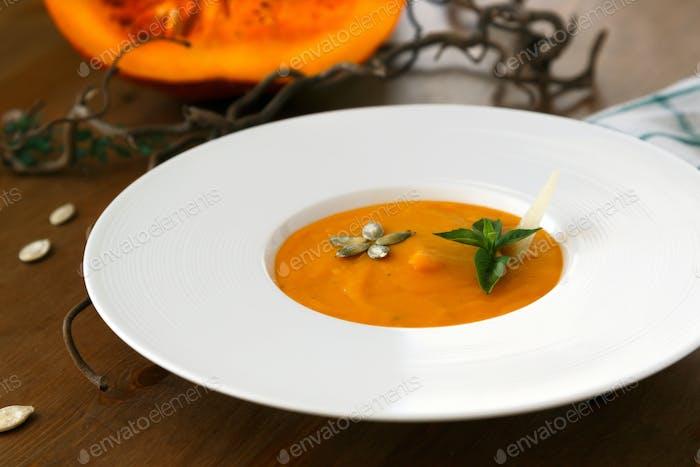 Pumpkin soup in a plate closeup