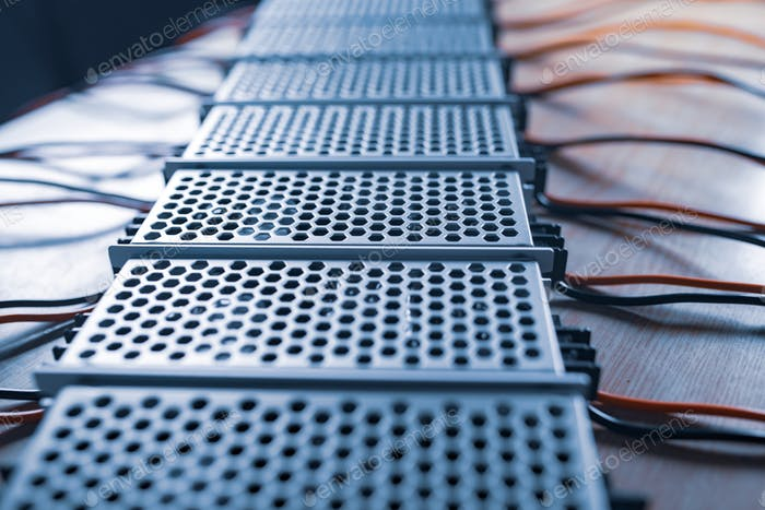 Close up of the metal mesh cases of power supply