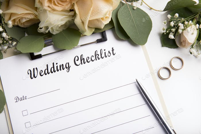 Close up of wedding checklist with empty space for date