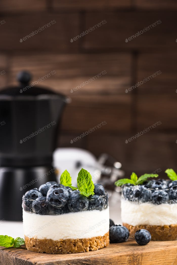 Blueberry cheesecake on wooden board