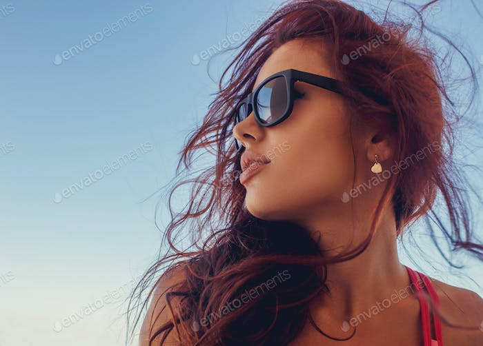 A  woman in a sunglasses.
