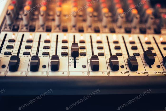 Detail of a music mixer in studio, dj working for new tracks. Music production with editing tools