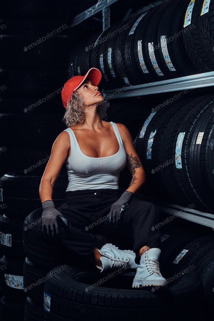 Portrait of female wofker at tyres warehouse