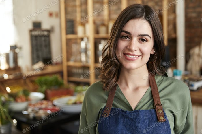 Portrait Of Female Owner Of Sustainable Plastic Free Grocery Store