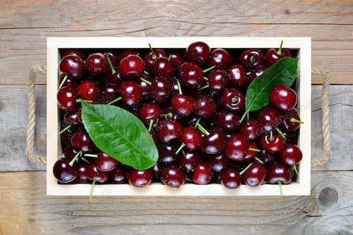 Cherry in wooden box close-up