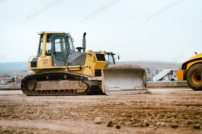 industrial building construction site mini bulldozer levelling soil