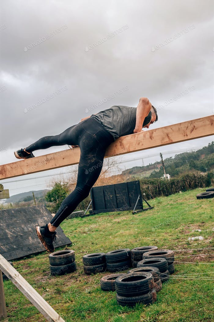 Participant in a obstacle course doing irish table
