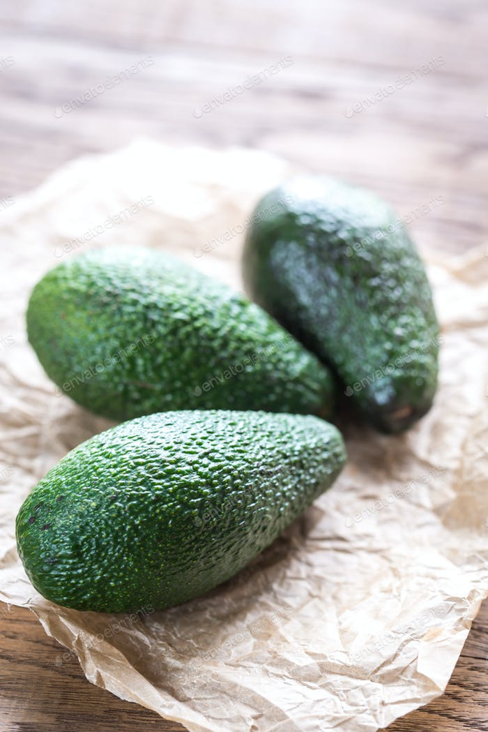 Avocado on the wooden background