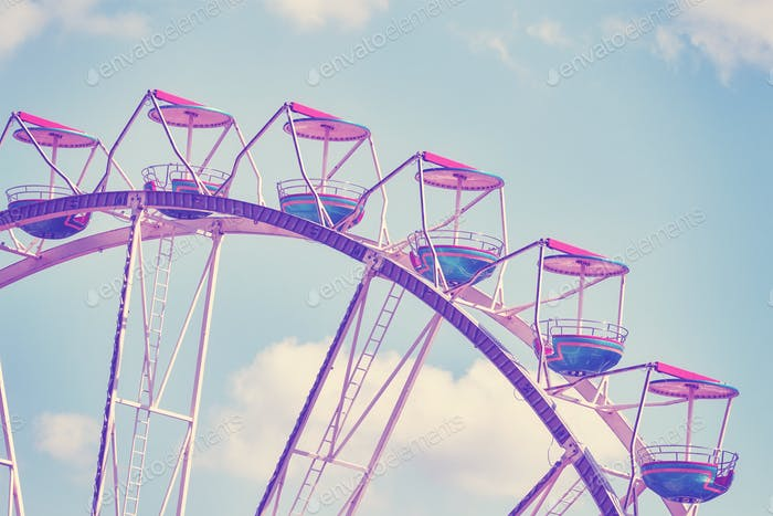 Vintage toned picture of a Ferris wheel.