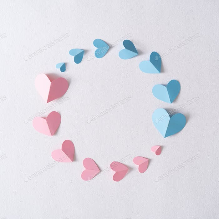 Creative layout with pink and blue paper hearts. Love flat lay. Minimal valentines day concept.