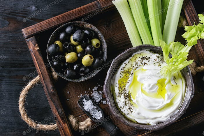 Fresh celery with yogurt dip