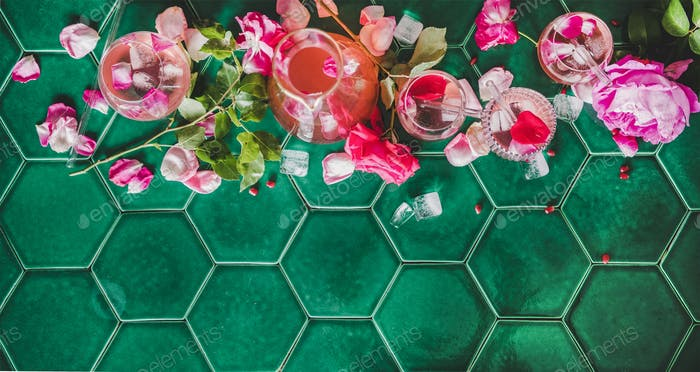 Flat-lay of rose lemonade with ice and rose petals