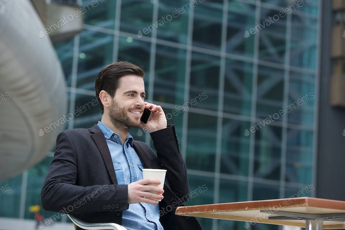 Man sitting in the city with mobile phone