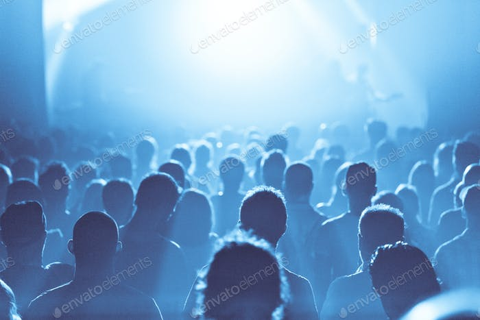 Blue ambiance and Crowd in silhouette during a Concert