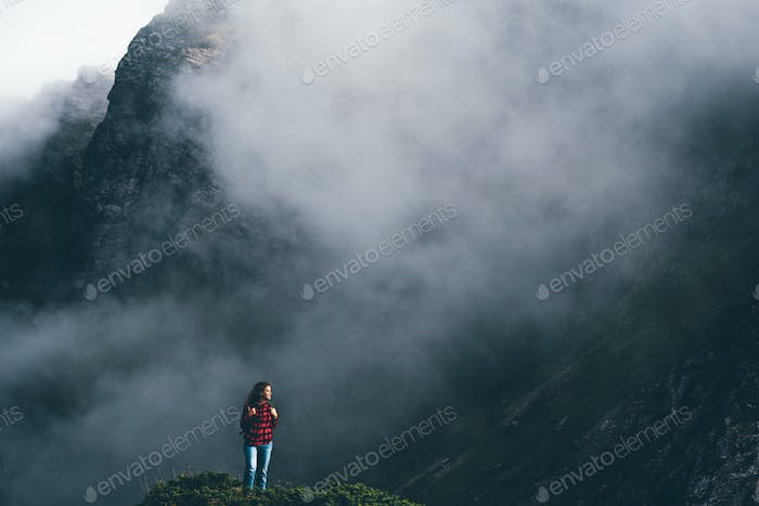 Young woman hiker enjoy the view on mountain peak.