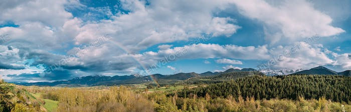 Spain. Panoramic View Of Pyrenees Mountains Landscape With Rainb