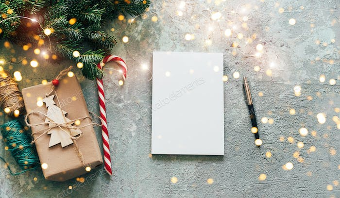 Christmas banner with mockup for text. A note with New Year's plans and goals on a decorated table.