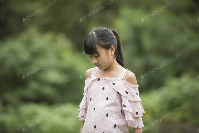 Portrait of Little Asian Girl Walking in the park