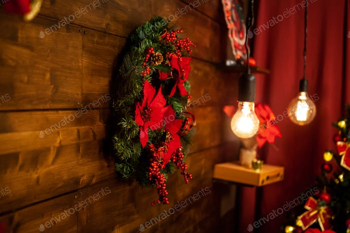 Christmas living room with beautiful christmas wreath on the wall