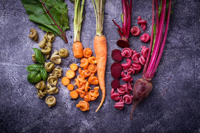 Colorful pasta with carrot, beetroot and basil