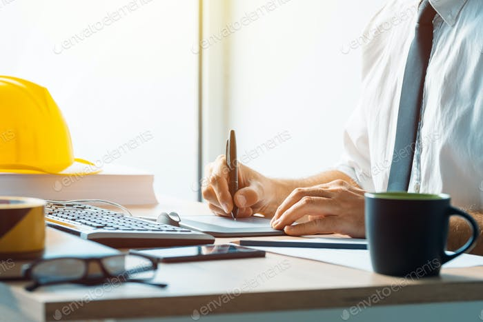 Civil engineer working with sketch pen tablet in architecture of