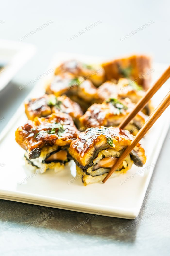 Grilled eel or unagi fish sushi maki roll with sweet sauce