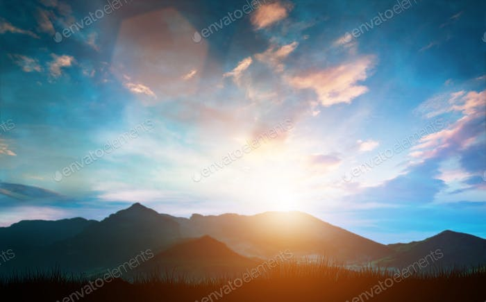 Mountain landscape with clouds and sunset.