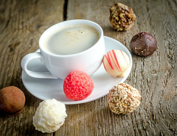Luxury chocolate candies and cup of coffee