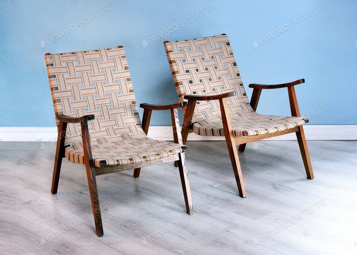 Two comfortable wooden easy chairs