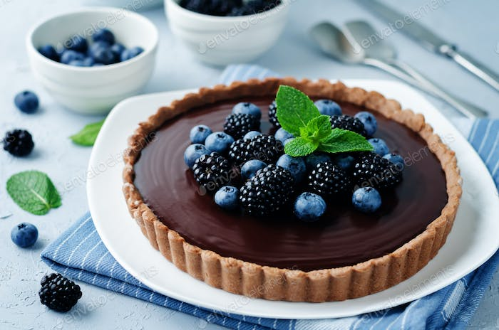 Chocolate tart with blackberries and blueberries.
