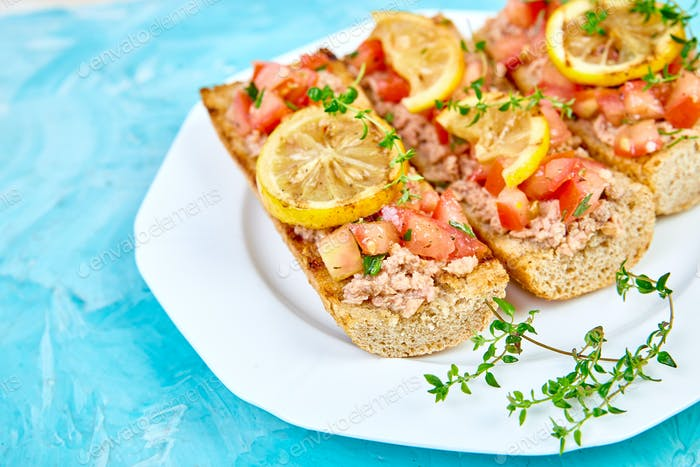 Appetizer bruschetta with tuna and tomatoes