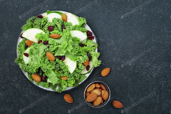 Kale salad with dried cranberry, green apples and almonds