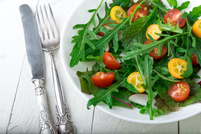 Vegetarian arugula salad with kumquat
