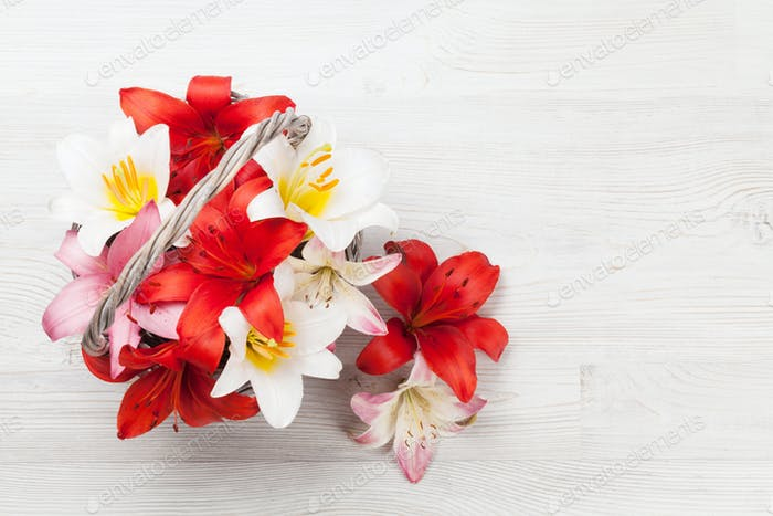 Colorful lily flowers basket