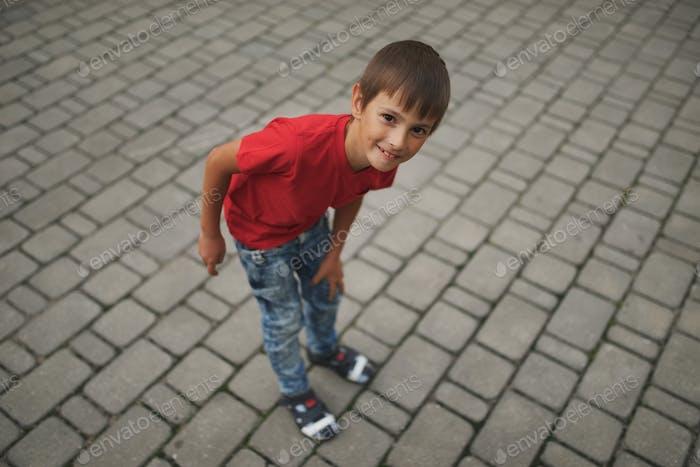 portrait of happy little boy outdoors