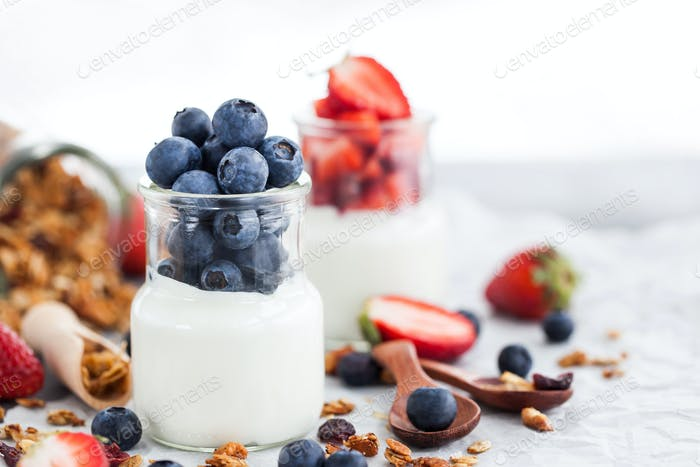 Delicious plain yogurt with fresh blueberry and strawberry in a