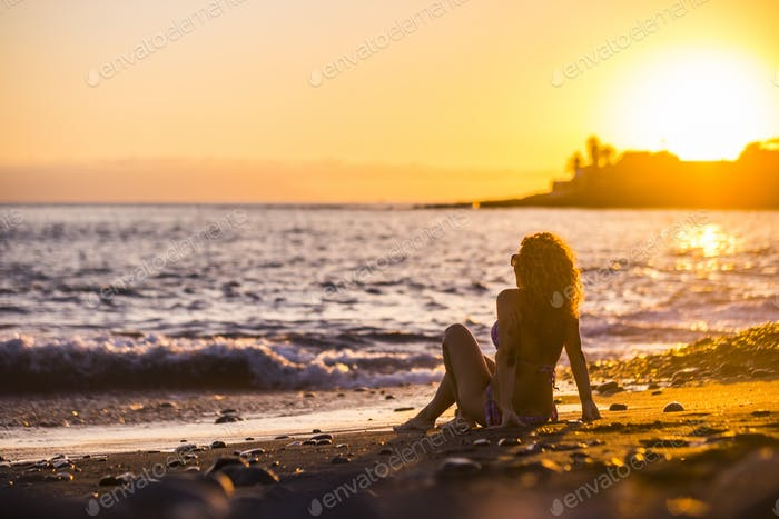 Tourist woman enjoy the sunset at the beach