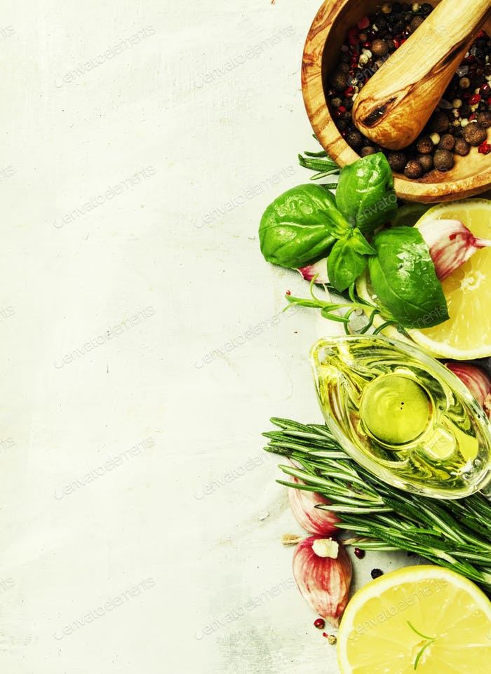 Food background, spices, herbs, olive oil and seasonings