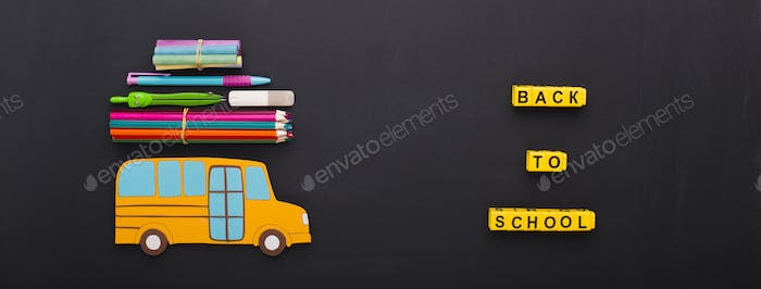 Yellow bus with stationery on chalk board background
