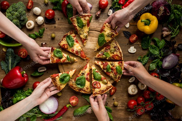 partial view of friends taking homemade pizza slices