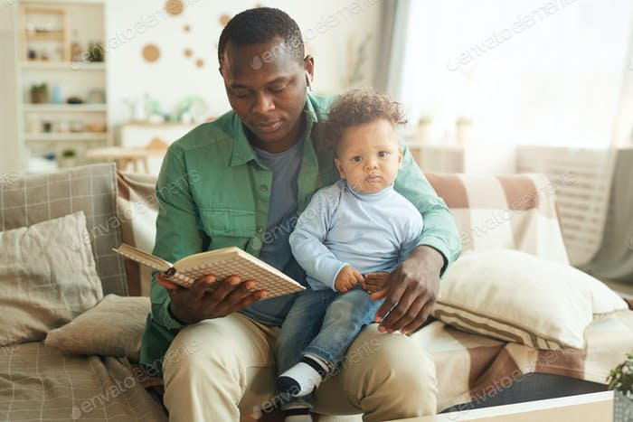 Loving Father Reading Book to Baby