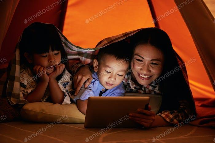 Family watching cartoons